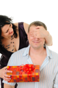 Royalty Free Photo of a Woman Giving a Man a Present