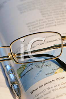 Royalty Free Photo of a Pair of Glasses on a Book
