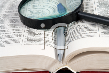 Royalty Free Photo of a Magnifying Glass on a Book