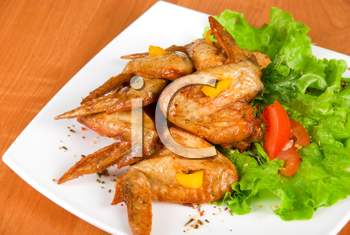 Royalty Free Photo of Roasted Chicken Drumsticks With Salad