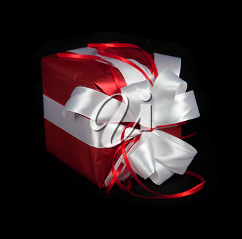 red gift box on black background
