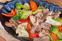 meat with vegetables at frying pan