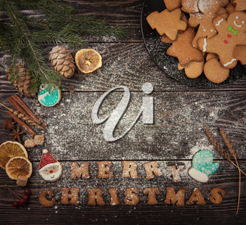 Different ginger cookies for new years and christmas on wooden background, top view