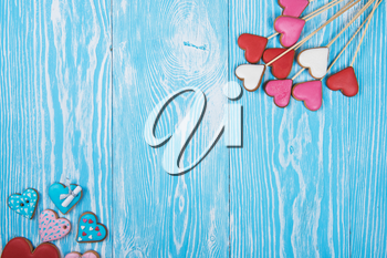 Gingerbreads for Valentines Day or wedding theme on blue wooden background