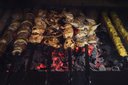 Grilling marinated shashlik on a grill