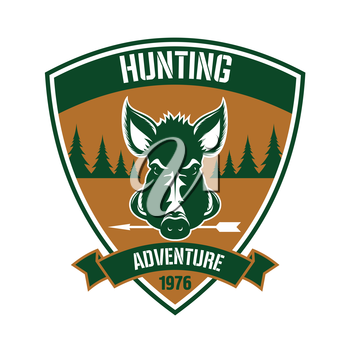 Brown triangular heraldic shield badge for hunting club design with a head of a wild hog with arrow in the mouth, flanked by fir trees and ribbon banner below