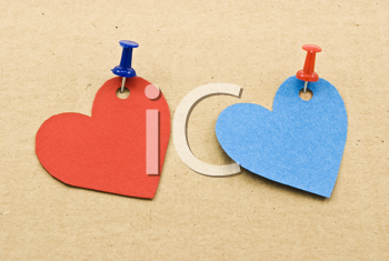 Royalty Free Photo of Heart Tags on Cardboard