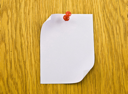 Royalty Free Photo of a Blank Tag on a Wooden Background