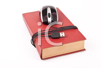 Royalty Free Photo of a Mouse Wrapped Around a Book