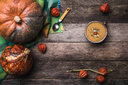 Rustic style Pumpkins and soup with seeds and ground cherry on wooden table. Autumn Season food photo