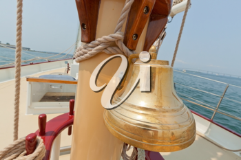 Brass bell on the private sail yacht.