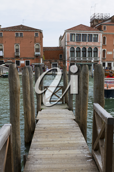 Venice, Italy - April 1, 2013: Street views of canals and ancient architecture in Venice, Italy. Venice is a city in northeastern Italy sited on a group of 118 small islands separated by canals and li