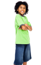 Happy boy standing with her arms crossed isolated over white