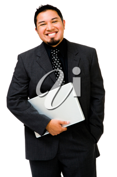 Happy businessman holding a laptop and posing isolated over white