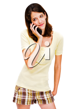 Young woman talking on a mobile phone isolated over white