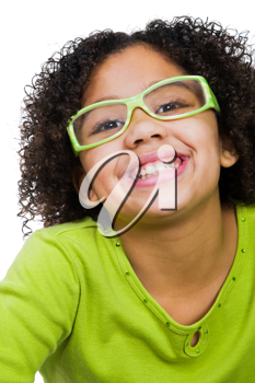 Girl wearing eyeglasses and smiling isolated over white