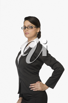 Businesswoman with hand on hip