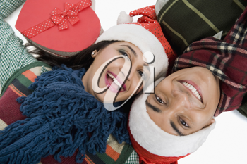 Close-up of a couple lying on a floor with Christmas present