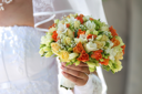 Royalty Free Photo of a Bride's Hand Holding a Bouquet
