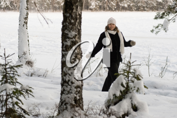Royalty Free Photo of a Woman in a Winter Forest