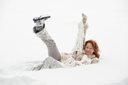 Royalty Free Photo of a Woman Playing in the Snow