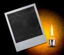 instant photo with black area with room to add image and candle .
