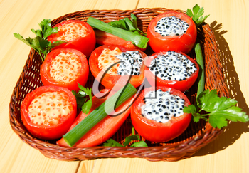 Tasty dish from tomato with stuffing and salad