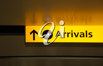 Royalty Free Photo of a Yellow Arrival Sign