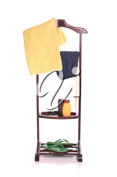 Royalty Free Photo of Beach Clothing on a Wooden Hanger