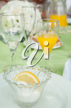 Royalty Free Photo of Lemon Ice Cream at a Table