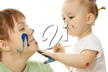 Royalty Free Photo of a Little Girl Painting Her Mother