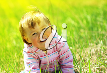 Royalty Free Photo of a Little Child in a Meadow