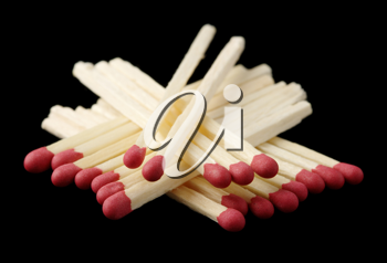 Royalty Free Photo of Red Matchsticks on a Black Background