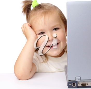 Royalty Free Photo of a Little Girl With a Laptop