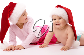 Royalty Free Photo of a Two Children in Santa Hats