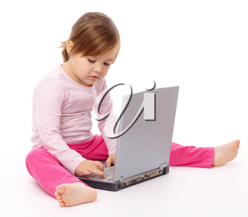 Royalty Free Photo of a Little Girl on the Floor With a Laptop