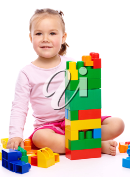Royalty Free Photo of a Little Girl Playing With Bricks