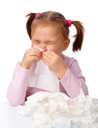 Royalty Free Photo of a Little Girl Blowing Her Nose