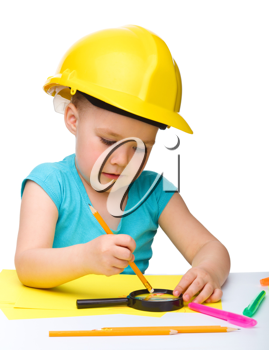 Royalty Free Photo of a Little Girl Wearing a Hardhat