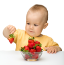 Royalty Free Photo of a Little Boy Eating Strawberries