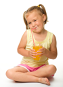 Royalty Free Photo of a Girl Drinking Orange Juice From a Straw
