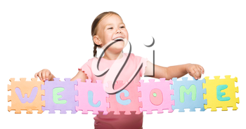 Cute little girl is holding Welcome slogan, isolated over white