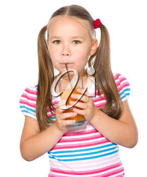 Little girl is drinking carrot juice using straw, isolated over white