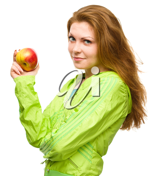 Young happy girl is holding red apple, isolated over white