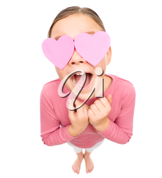 Little girl is holding hearts over her eyes, fisheye portrait, valentine concept, isolated on white