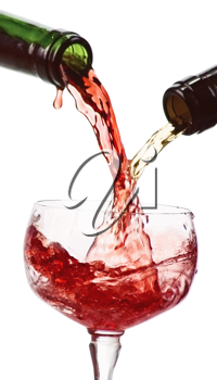white and red wine  being poured into a wine glass isolated on white