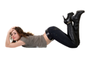 Royalty Free Photo of a Woman Lying on the Floor With Her Knees Bent