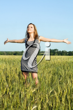 Royalty Free Photo of a Woman in a Field