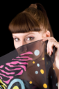 Royalty Free Photo of a Woman Hiding Behind a Scarf