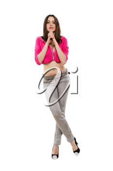 Inviting young brunette posing in grey jeans and pink jacket. Isolated on white